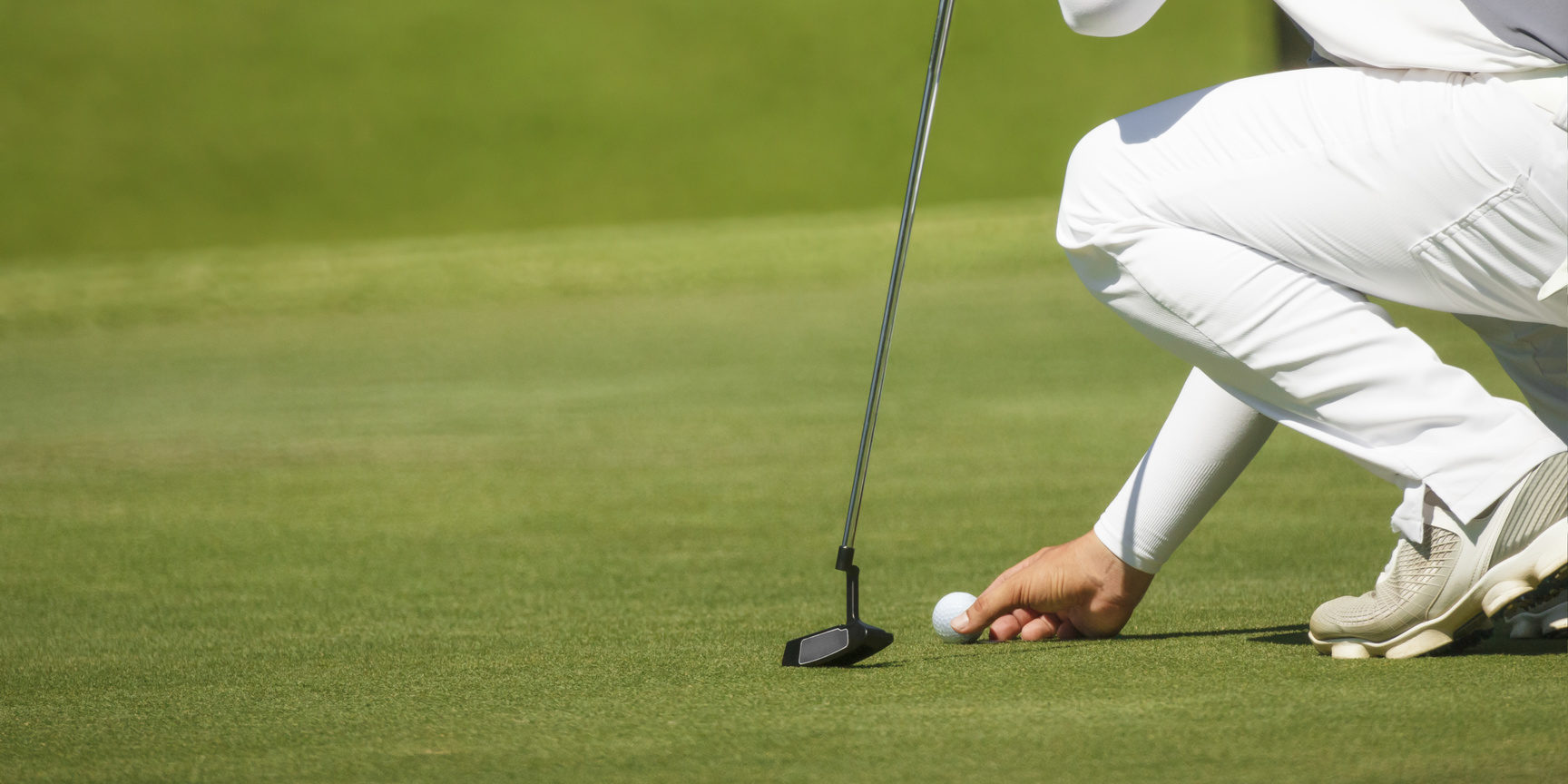 golfer marks his position on a green